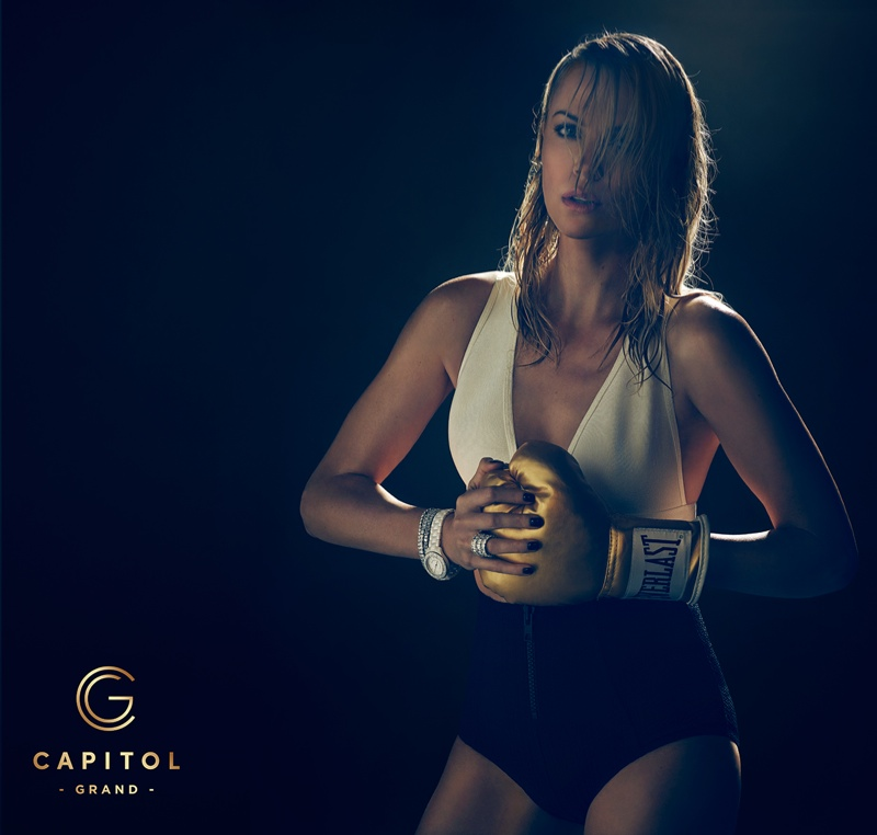 Charlize puts on her boxing gloves in this shot