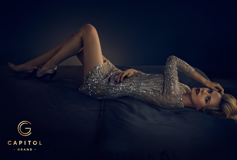 In this image, Charlize wears a slinky, silver dress