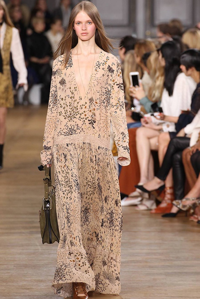 960a2c252c92 A model wears a long maxi dress on Chloe s fall 2015 runway. The 1970s  inspired
