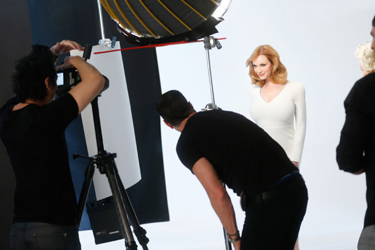 Christina Hendricks behind the scenes on set of Clairol campaign with her new blonde hair.