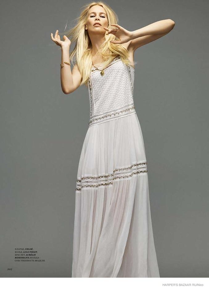 Cluadia models a white Chloe dress.