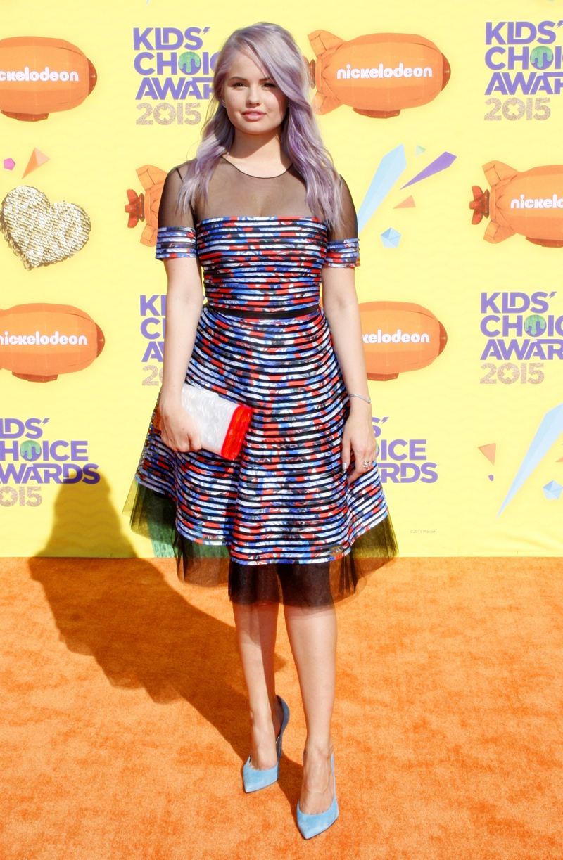 Debby Ryan opted for a multi-color print dress with sheer detail. Photo: David Gabber / PRPhotos.com
