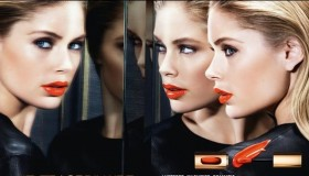 Doutzen Kroes stars in L'Oreal Paris L'Extraordinaire advertisement modeling a coral red lipstick.