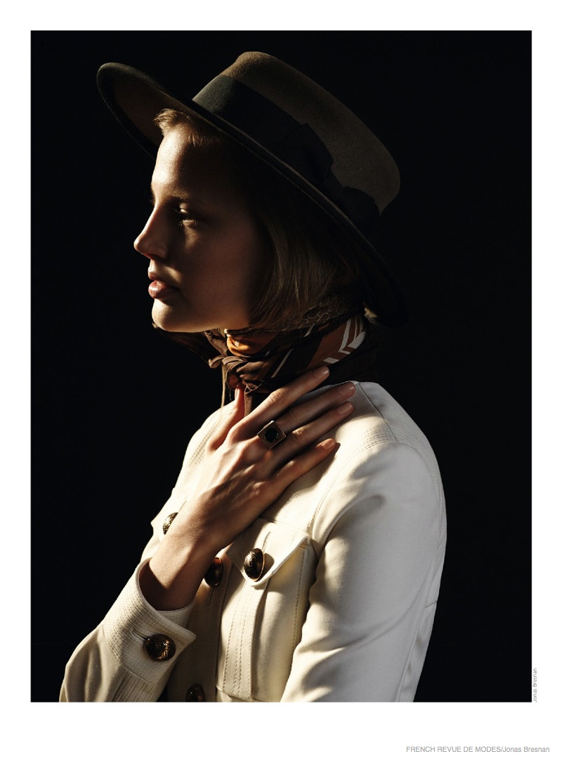 A utilitarian inspired dress and masculine hat make a bold statement.