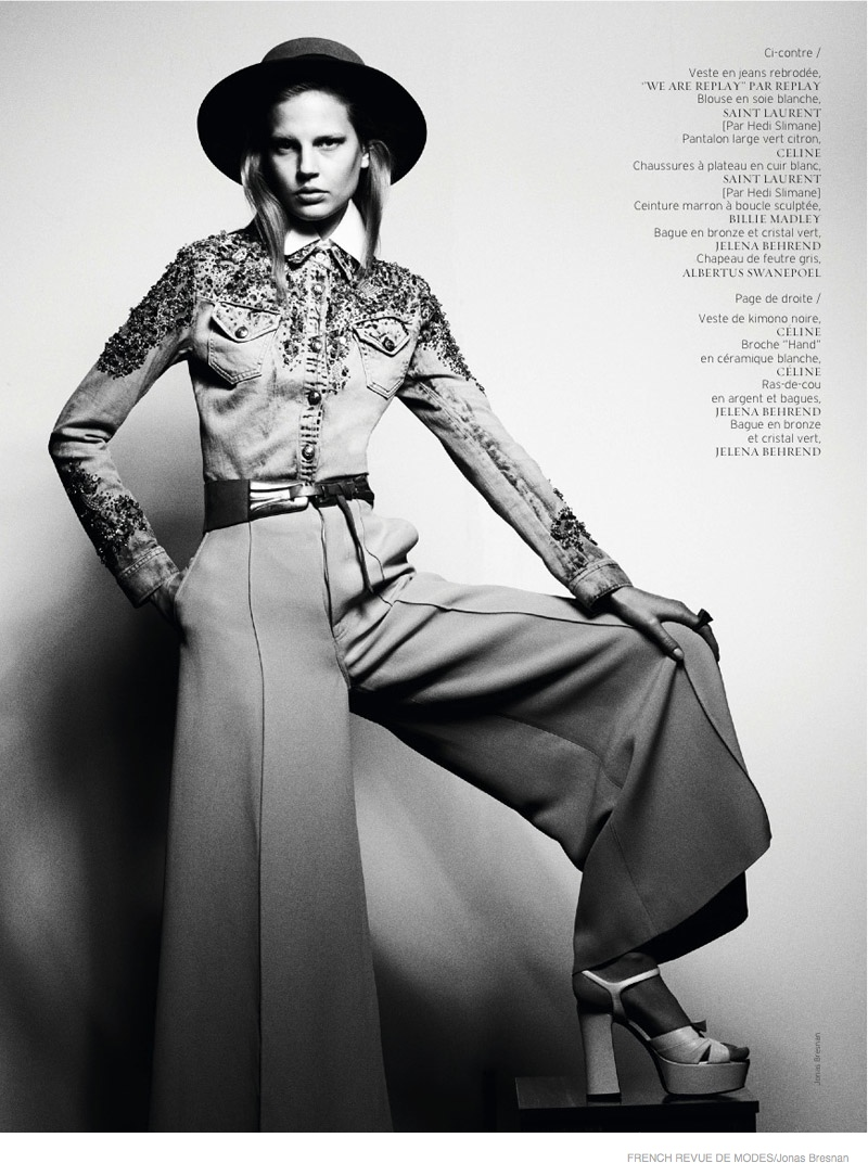 An embellished top, wide-brimmed hat and flared pants stand out.