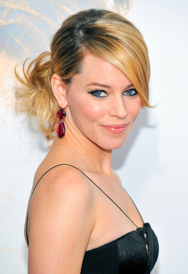 Elizabeth Banks sports a messy side bun with a sleek front and bang. Photo: Shutterstock.com