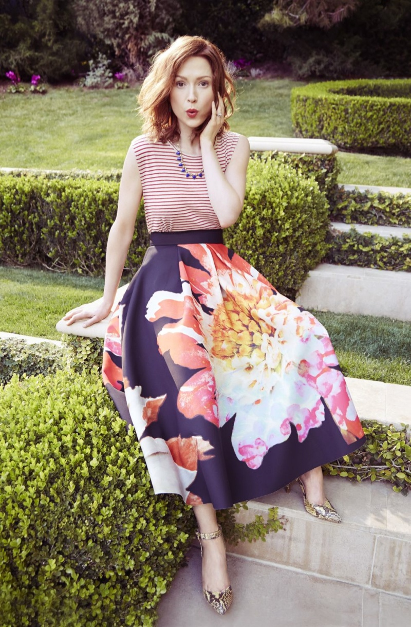 The redhead wears colorful spring styles for the fashion feature.