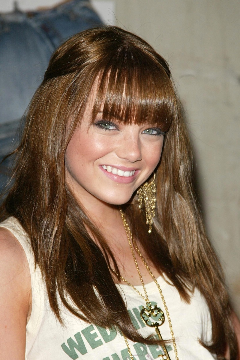 fresh faced emma stone with auburn brown hair and bangs in 2006