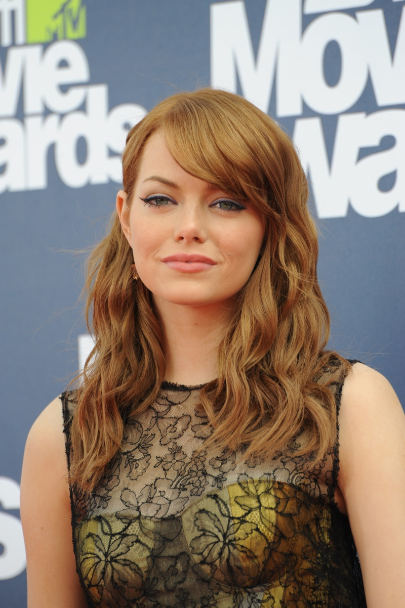 In 2011, Emma Stone embraced a more strawberry red shade with a wavy ...