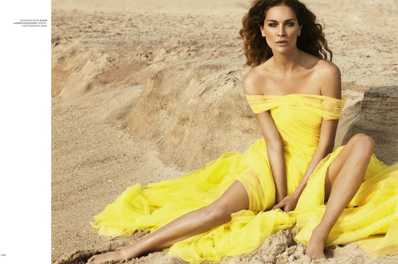Mellow yellow: Erin dons a Ralph Lauren collection dress in a sunny shade.