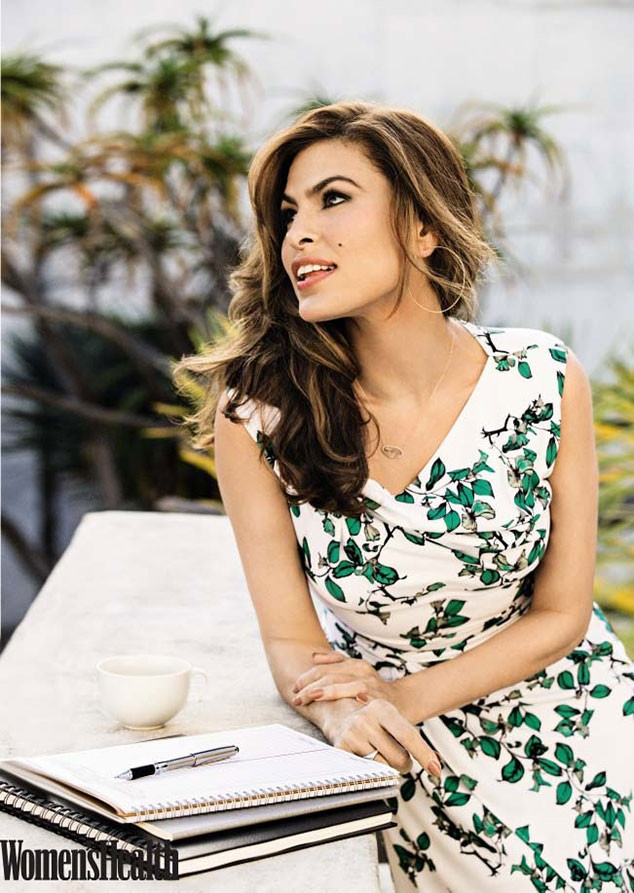 Eva glows in a floral print dress for the feature.