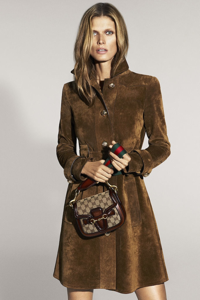A model wears a brown suede jacket dress from Gucci in the brand's spring-summer 2015 campaign.