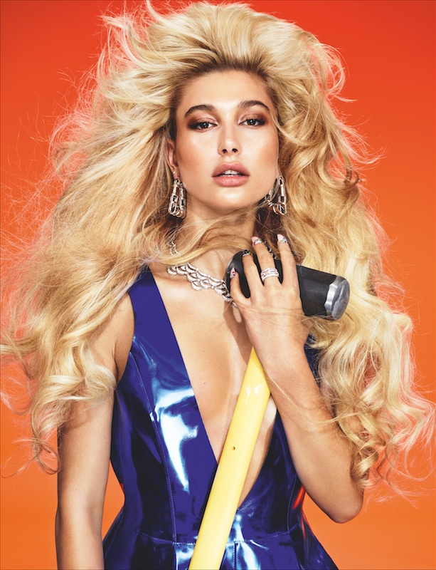 Posing with a hammer, Hailey stuns in a blue dress while accessorized with jewelry