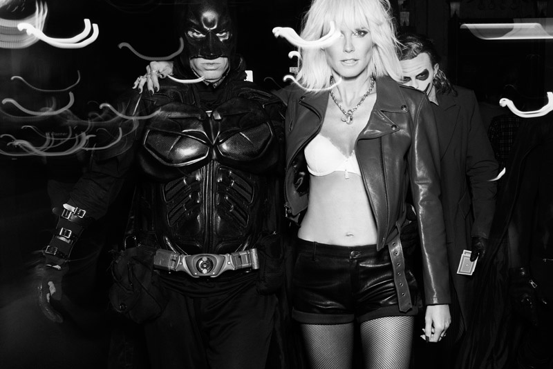 Posing with Batman, Heidi flaunts her supermodel figure in a leather jacket, bra and shorts. Photo: Rankin/Hunger.
