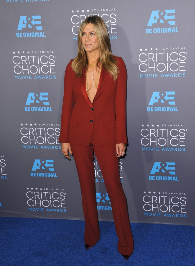 Jennifer Anison wears a red, burgundy Gucci pant suit without a top at the Critics' Choice Awards. Photo: Shutterstock.com