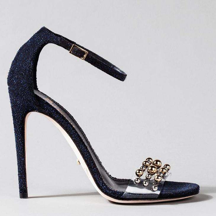 Jerome Rousseau went in a nontraditional direction with a shoe inspired by the stroke of midnight—playing off the color of the sky at night. The clear strap serves as a reminder of crystal slipper with gold and silver embellishments.