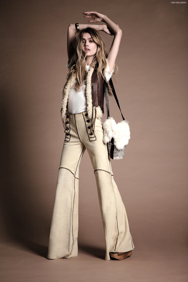 (This Image & Next) 70s Leather Pants, Rolling Stones Tour Tee & Vintage Fur Bag available at Stoned Immaculate Vintage; Leather Shearling Vest & Gold Bangle available at Greta Garbage Vintage