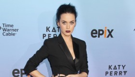 Katy Perry suited up in a Balenciaga tuxedo dress at her Prismatic world tour screening. Photo: Kazuki Hirata / HollywoodNewsWire.net / PRPhotos.com