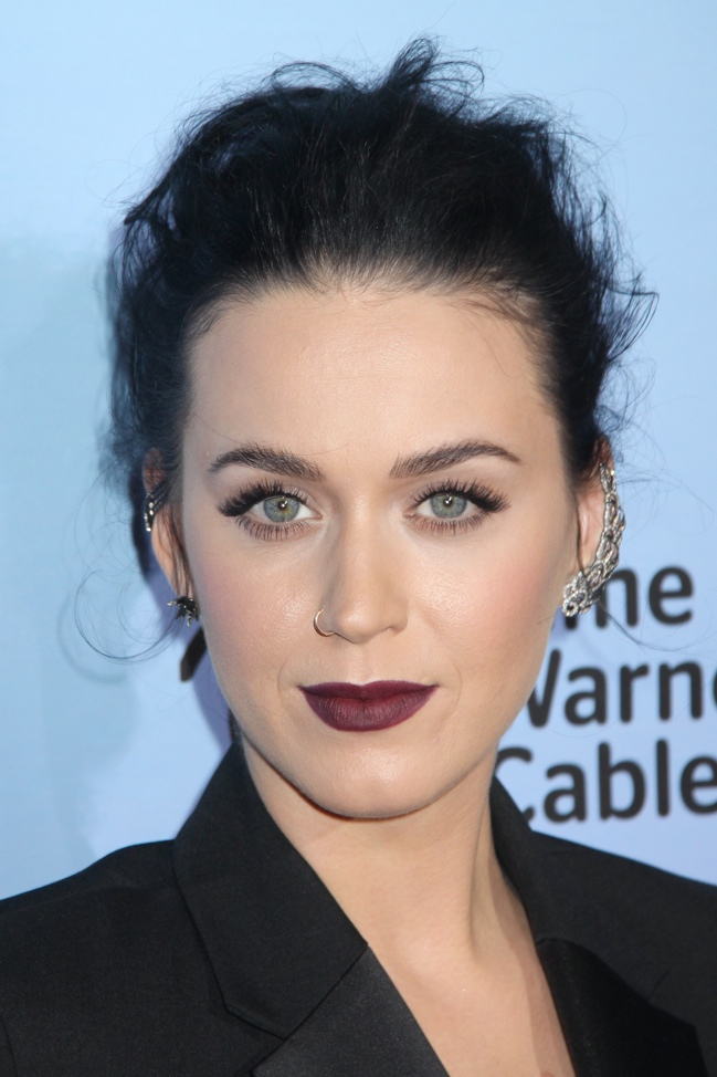 Katy's beauty look: a messy updo with a dark plum-colored lip and subtle cat-eye. Kazuki Hirata / HollywoodNewsWire.net / PRPhotos.com