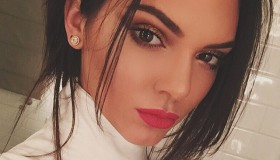 Kendall Jenner shows off a red lipstick look on Instagram.