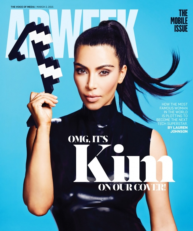 Clad in a black leather dress, Kim Kardashian covers the March 2, 2015 issue of Adweek.