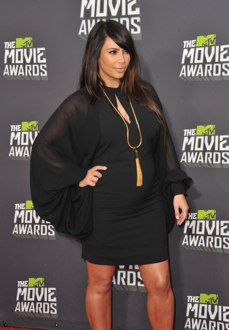 Kim Kardashian opted for a short, black Saint Laurent dress with long sleeves while pregnant with North at the 2013 MTV Movie Awards. Photo: Tinseltown / Shutterstock.com