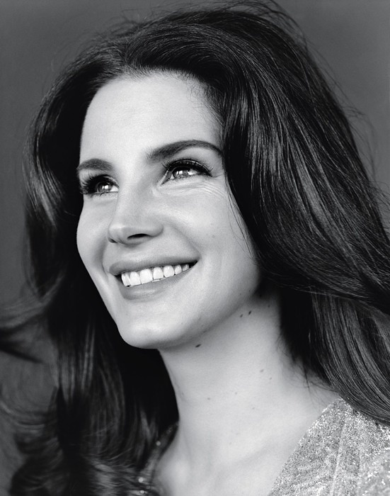 Lana is all smiles for this black and white photo.