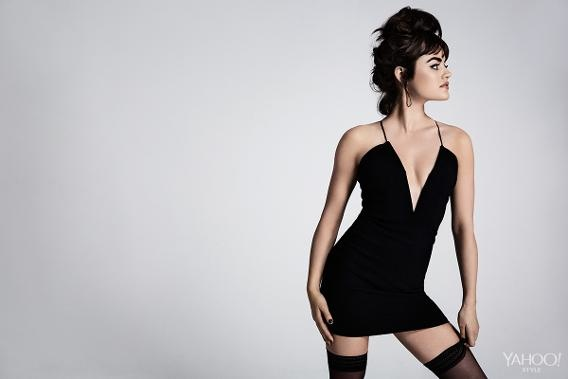 Lucy wears a little black dress with black stockings in this sexy image.