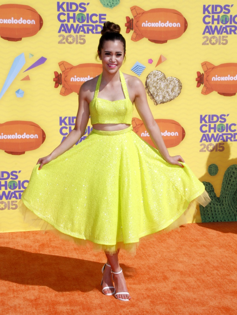 Megan Nicole opted for a matching yellow crop top and flared skirt. Photo: David Gabber / PRPhotos.com