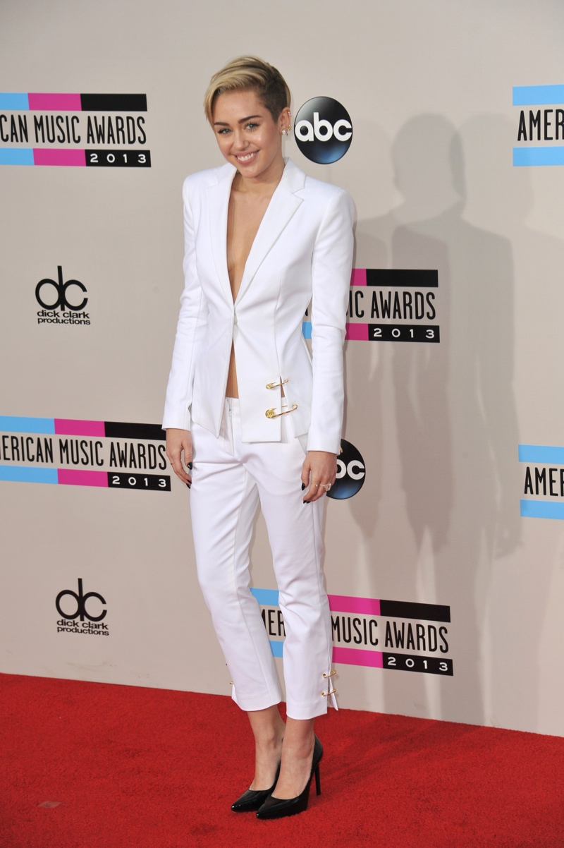 Miley Cyrus opts for a Versus Versace white pant suit with cropped trousers. Photo: Shutterstock.com.