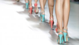 Models walk at a fashion show. Photo: catwalker/Shutterstock.com