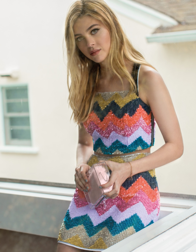 Nicola wears colorful prints for the fashion feature.
