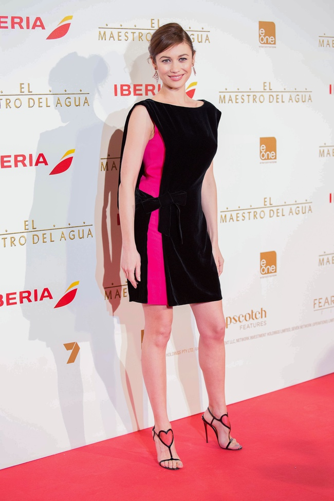 Olga Kurylenko dons a Lanvin black and pink dress at 'The Water Diviner' Madrid premiere. Solarpix / PR Photos
