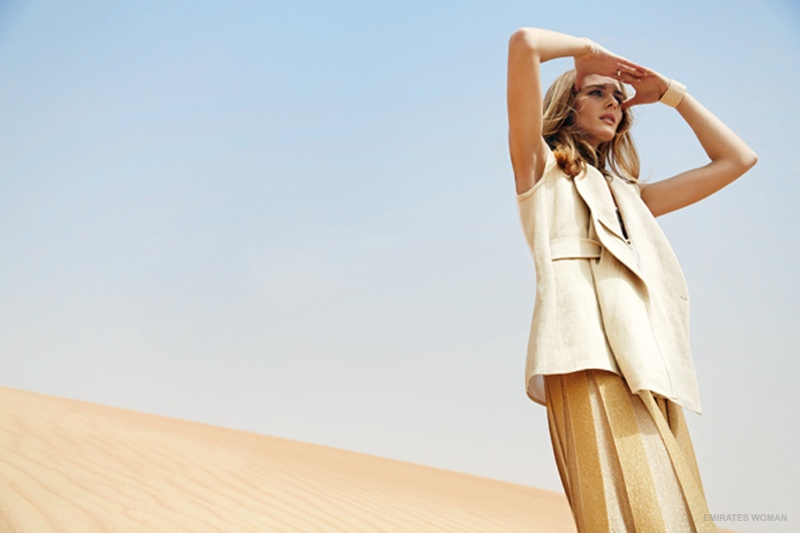 Olivia looks out to desert in neutral hues.