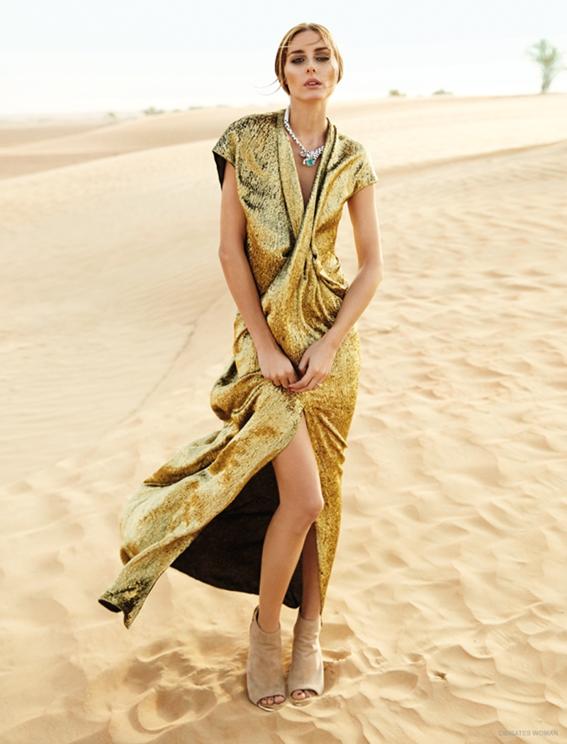 Olivia is a golden girl in a glittering metallic dress with jewelry from Cartier.