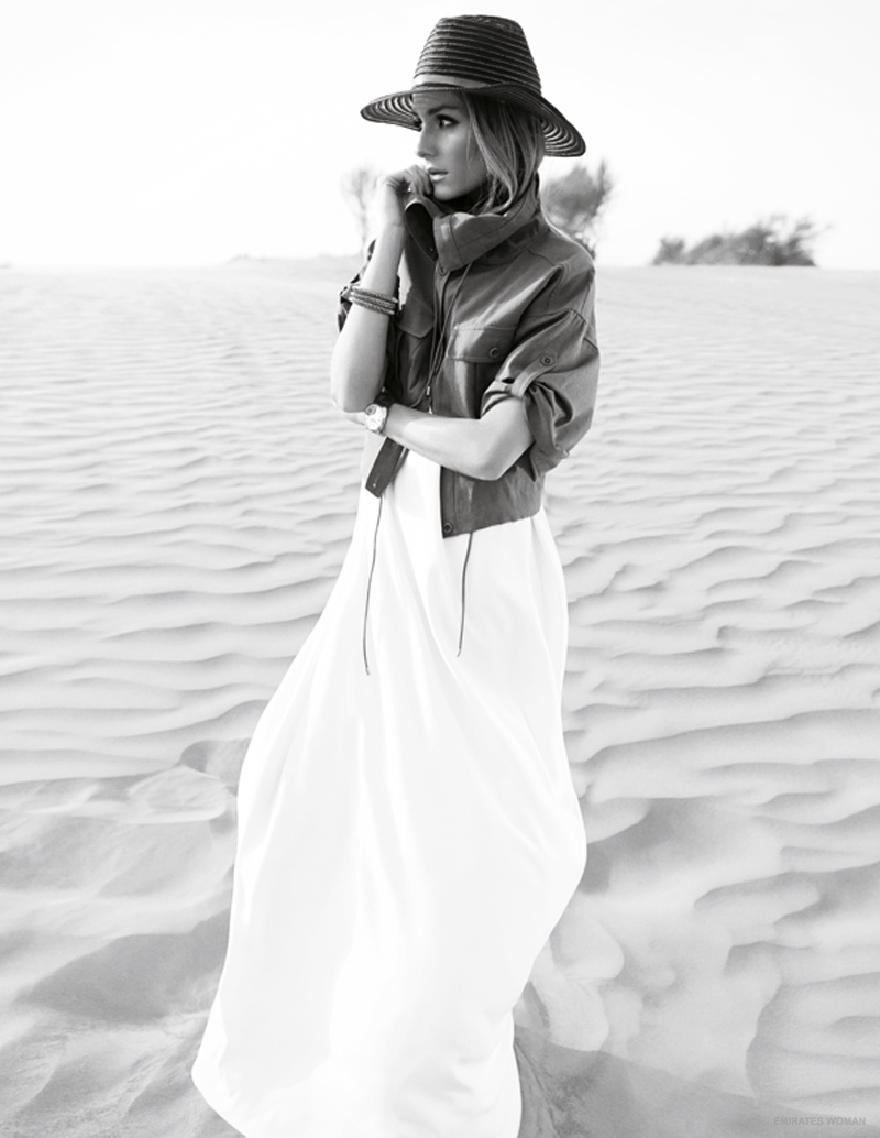 A wide-brimmed hat and white dress, protect Olivia from the heat.