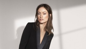 Olivia Wilde wears a H&M Conscious jumpsuit in black.