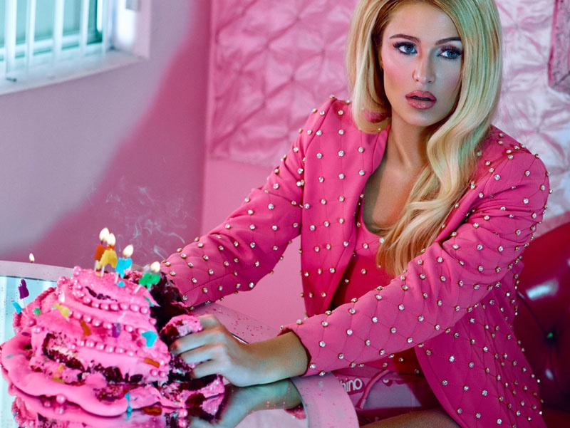 Decked out in a pink Moschino look, Paris poses with a destroyed birthday cake.