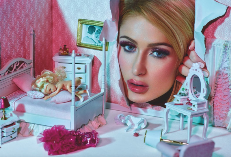 Paris looks into a doll house for this eery image.