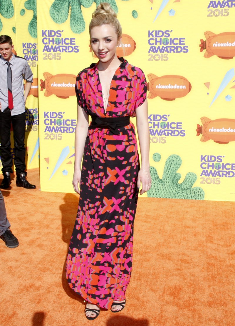 Peyton List donned a black, orange and pink print dress. Photo: David Gabber / PRPhotos.com