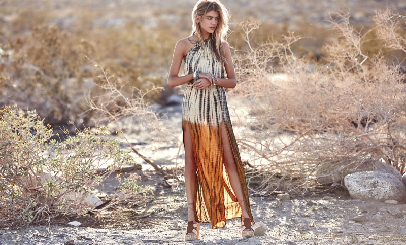 The blonde models a halter maxi dress with 2 slits