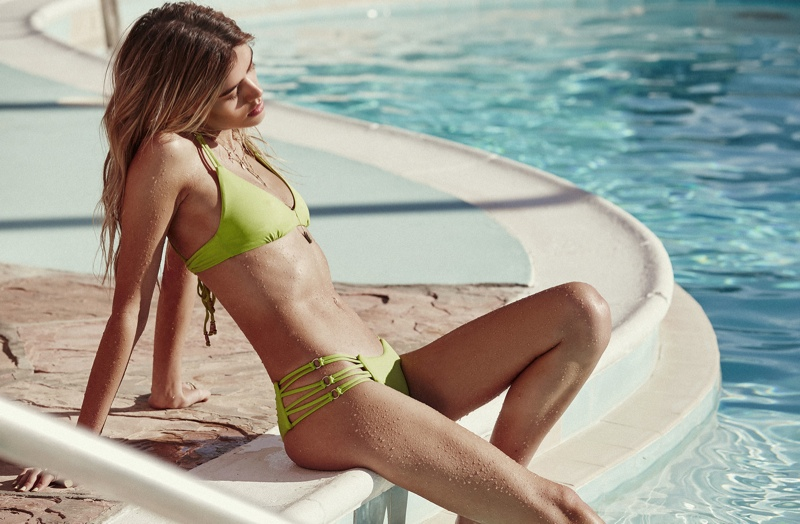 A two-piece bikini in green adds a pop of color