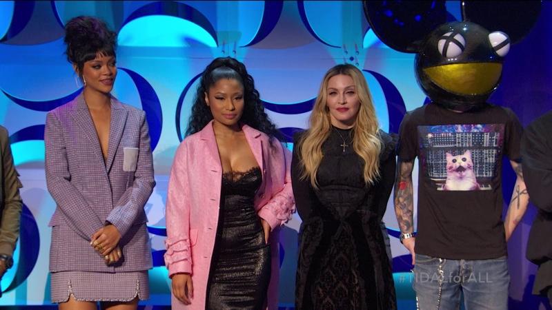 Rihanna wears a Dior look at a Tidal event with Nicki Minaj, Madonna and Deadmau5. Photo via Tidal