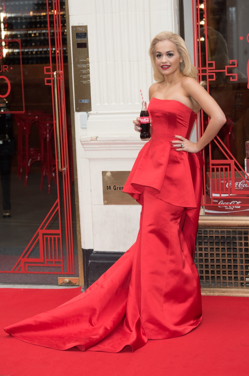 Rita Ora wears a red Veni Vici dress at Coca-Cola Event in London. Photo: Landmark/PR Photos
