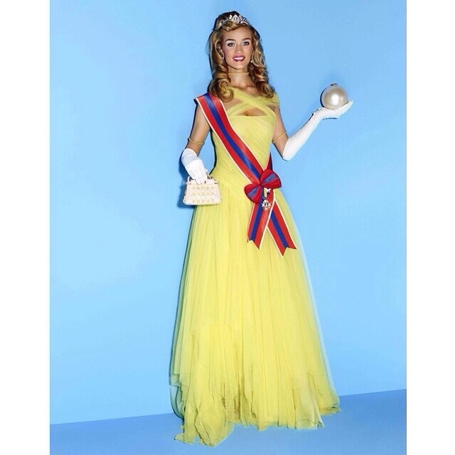 Rosie is pageant perfect in a yellow gown.