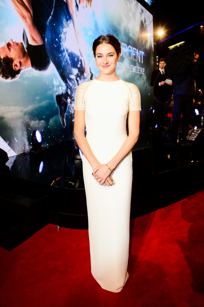 Shaiiene Woodley wears a white Ralph Lauren Collection dress at the 'Insurgent' world premiere in London.