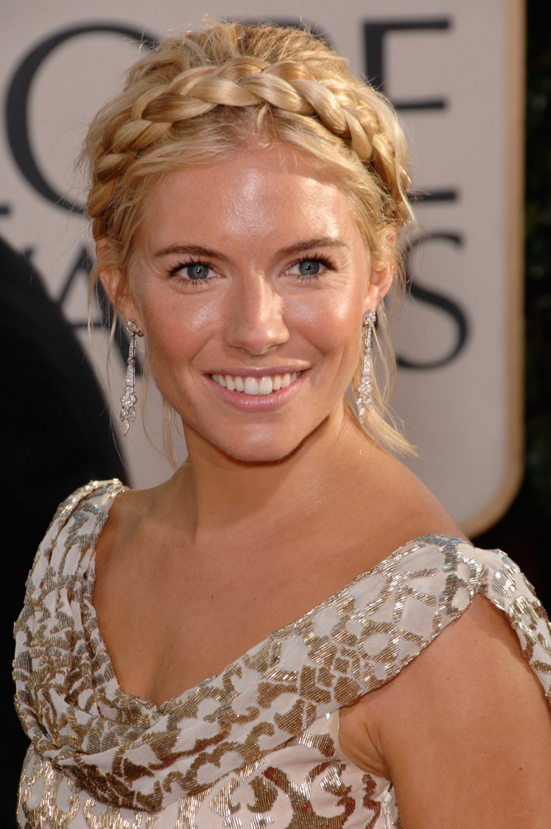 Sienna Miller tries a braided milkmaid hairstyle. Photo: Shutterstock.com