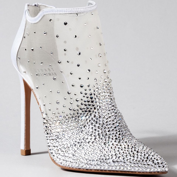 Stuart Weitzman went for a more modern shoe silhouette with a diamond and see-through bootie.