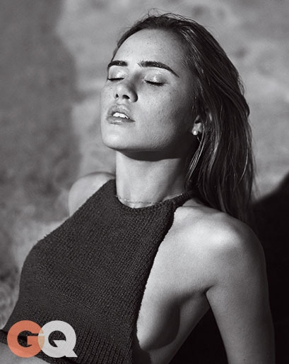 Suki Waterhouse soaks up the sun in this black and white image.