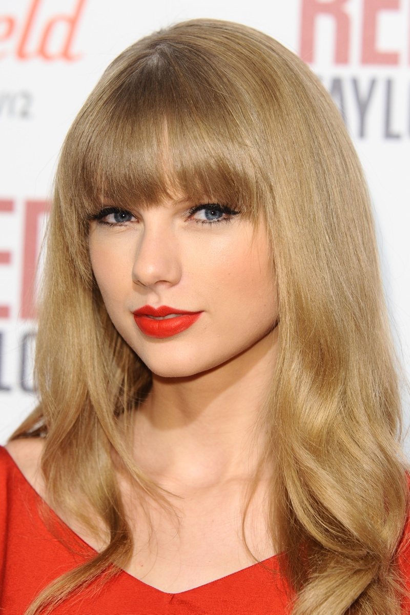 Taylor Swift in London in 2012 with pouty red lips. Photo: Featureflash/Shutterstock.com